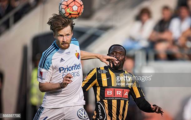 Jacob Une Larsson of Djurgardens IF and John Owoeri of BK Hacken run for the ball during the Allsvenskan match between BK Hacken and Djurgardens IF...