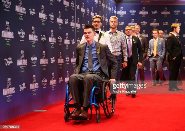 Jacob Wasserman leads his Humboldt Broncos teammates onto the red carpet as they arrive at the 2018 NHL Awards presented by Hulu at the Hard Rock...