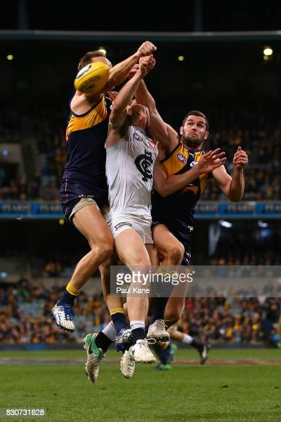 Jacob Weitering of the Blues contests for a mark against Drew Petrie and Jack Darling of the Eagles during the round 21 AFL match between the West...