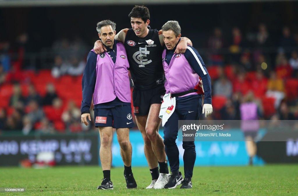 Jacob Weitering of the blues suffers an injury during the round 19 AFL match between the Gold Coast Suns and the Carlton Blues at Metricon Stadium on July 28, 2018 in Gold Coast, Australia.