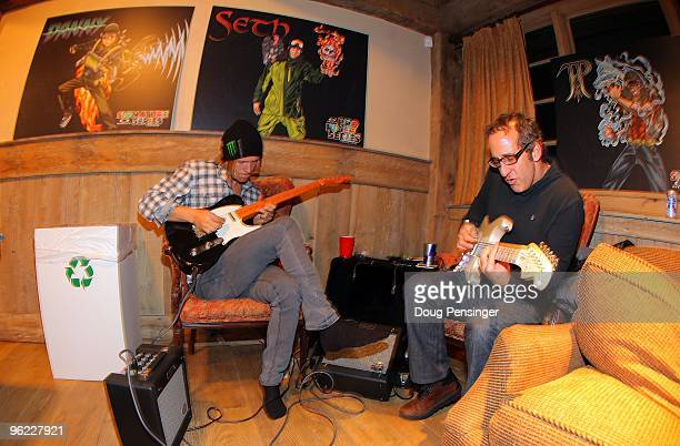 Jacob Wester and Steve Zeldin jam on the guitar in the back room at the Oakley/Red Bull Party prior to Winter X Games 14 at Buttermilk Mountain on...