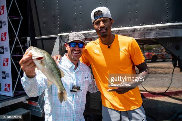 Jacob Wheeler and Paul George showing their catch at the 2nd annual Paul George fishing tournament at Castaic Lake on August 4 2018 in Los Angeles...