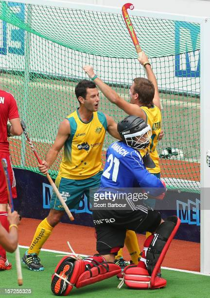 Jacob Whetton of Australia celebrates with Jamie Dwyer after scoring a goal during the match between Australia and Belgium on day one of the...