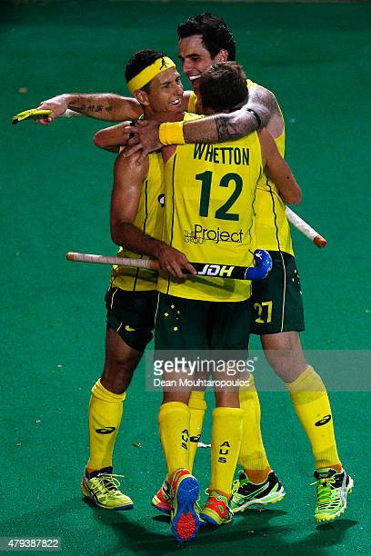Jacob Whetton of Australia celebrates with team mates after he scores a goal during the Fintro Hockey World League Semi-Final match between Australia...