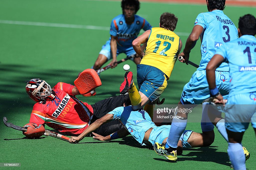 Jacob Whetton of Australia contests for the ball against goal keeper Sushant Tirkey of India during the match between Australia and India during day five of the 2012 Champions Trophy at the State Netball and Hockey Centre on December 8, 2012 in Melbourne, Australia.