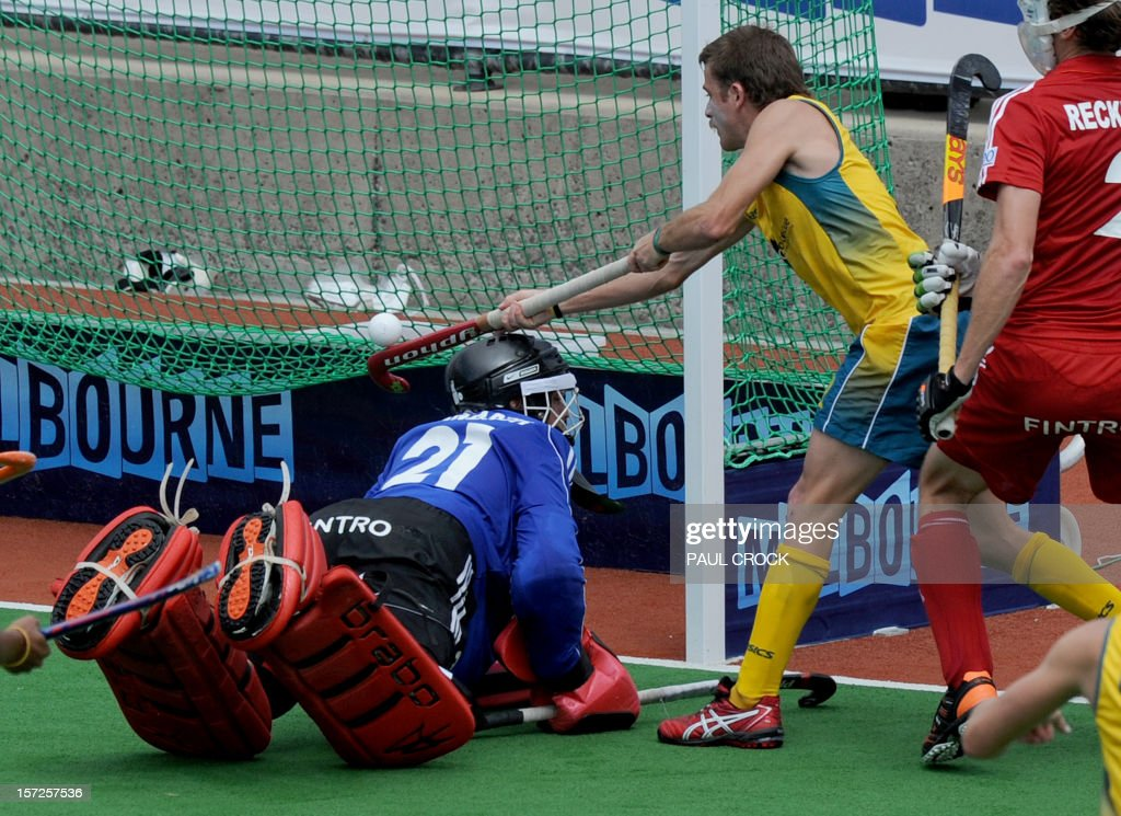 Jacob Whetton of Australia flicks the ball over Belgian goal keeper Vincent Vanasch to score during the their pool B match at the Mens Hockey Champioships Trophy in Melbourne on December 1, 2012. Australia leads 2-0 at half time. RESTRICTED TO EDITORIAL USE NO ADVERTISING USE NO PROMOTIONAL USE NO MERCHANDISING USE. AFP PHOTO/Paul CROCK