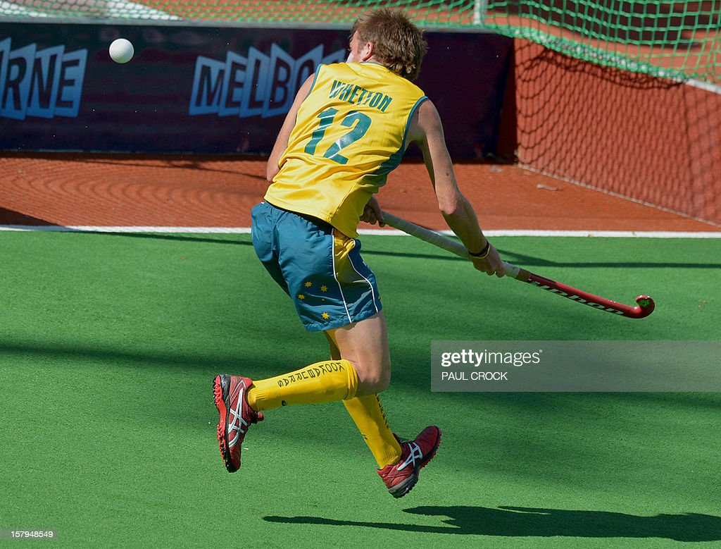 Jacob Whetton of Australia plays the ball in front of an open goal during their second semifinal against India at the men's Hockey Champions Trophy tournament in Melbourne on December 8, 2012. IMAGE STRICTLY RESTRICTED TO EDITORIAL USE - STRICTLY NO COMMERCIAL USE AFP PHOTO/Paul CROCK