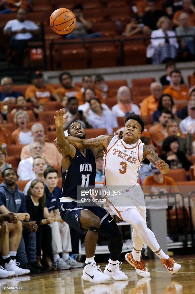 Jacob Young #3 of the Texas Longhorns and Jordan Reed #11 of the New Hampshire Wildcats battle for the loose ball at the Frank Erwin Center on November 14, 2017 in Austin, Texas.