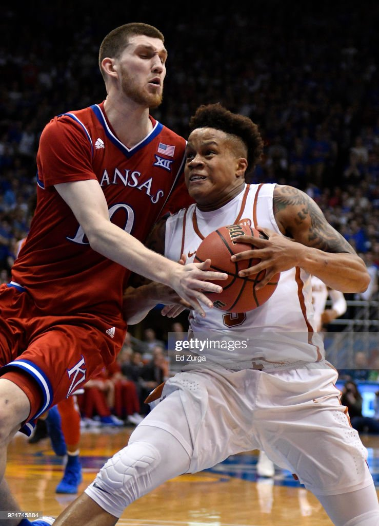 Jacob Young #3 of the Texas Longhorns drives to the basket against Sviatoslav Mykhailiuk #10 of the Kansas Jayhawks at Allen Fieldhouse on February 26, 2018 in Lawrence, Kansas.