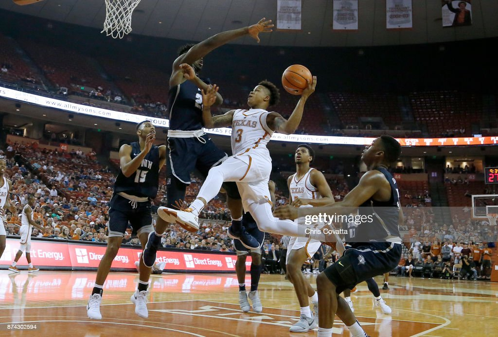 Jacob Young #3 of the Texas Longhorns leaps to the basket against the New Hampshire Wildcats at the Frank Erwin Center on November 14, 2017 in Austin, Texas.
