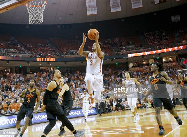 Jacob Young of the Texas Longhorns leaps to the basket against the Oklahoma State Cowboys at the Frank Erwin Center on February 24 2018 in Austin...