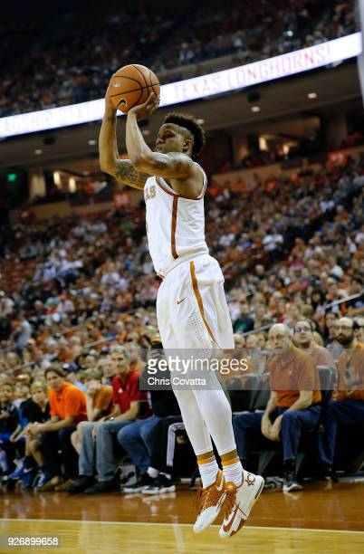 Jacob Young of the Texas Longhorns shoots the ball against the Oklahoma State Cowboys at the Frank Erwin Center on February 24 2018 in Austin Texas