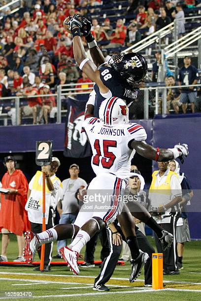 Jacob Younger of the Florida International Golden Panthers catches a touchdown over Andrew Johnson of the Louisville Cardinals on September 22 2012...