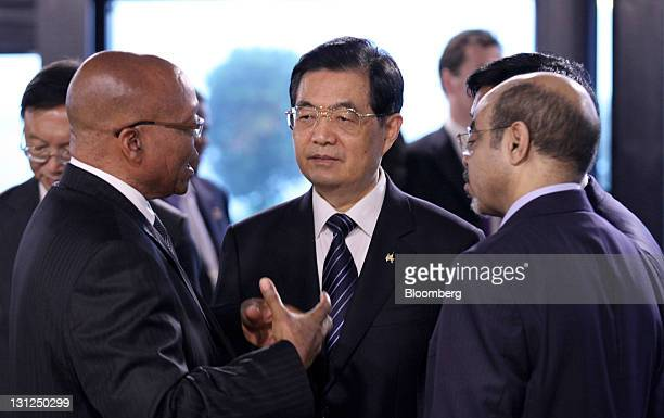 Jacob Zuma South Africa's president left speaks with Hu Jintao China's president center and Meles Zenawi Ethiopia's prime minister ahead of the first...