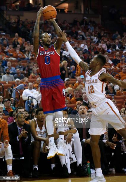 Jacobi Boykins of the Louisiana Tech Bulldogs shoots over Kerwin Roach II of the Texas Longhorns at the Frank Erwin Center on December 16 2017 in...