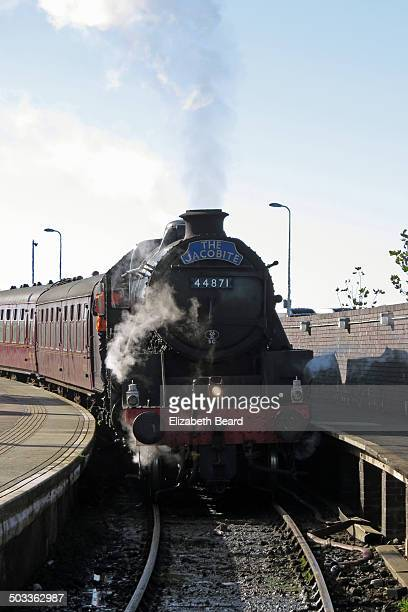 jacobite steam train arrives in mallaig - mallaig stock photos and pictures
