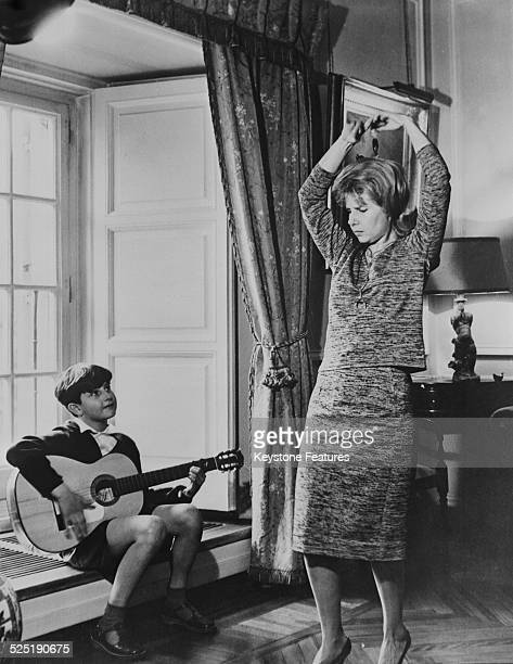 Jacobo FitzJames Stuart 23rd Count of Siruela plays the guitar for his mother Cayetana FitzJames Stuart 18th Duchess of Alba at the Liria Palace...