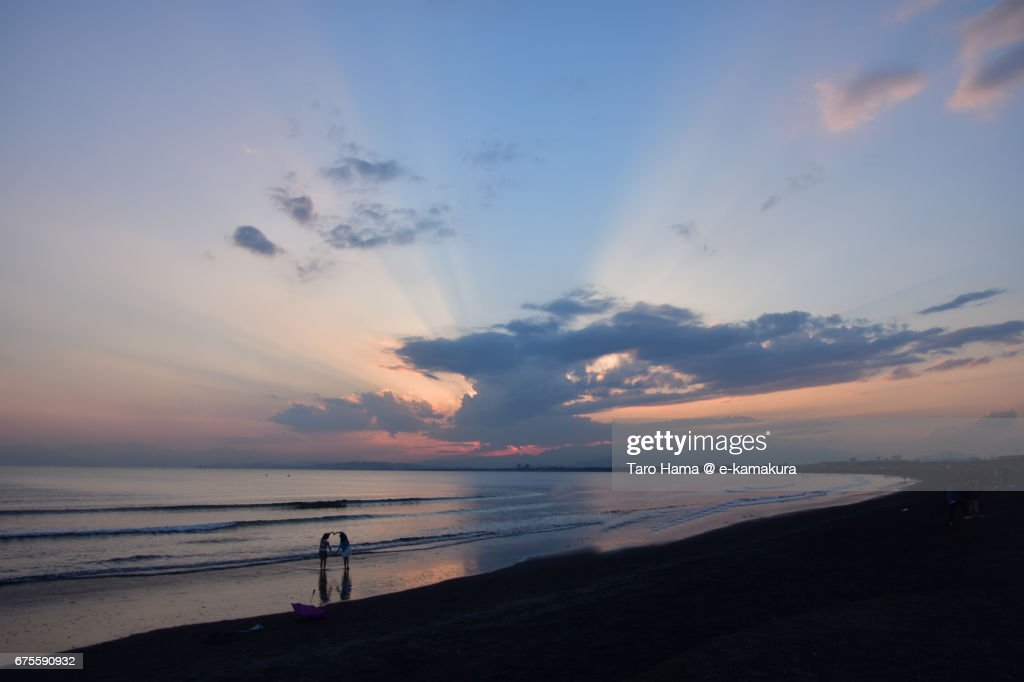 Jacob's ladder and friends on the sunset beach : ストックフォト