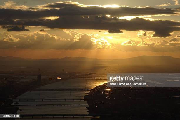 Jacob's ladder on the Osaka city and Yodo river sky view from airplane