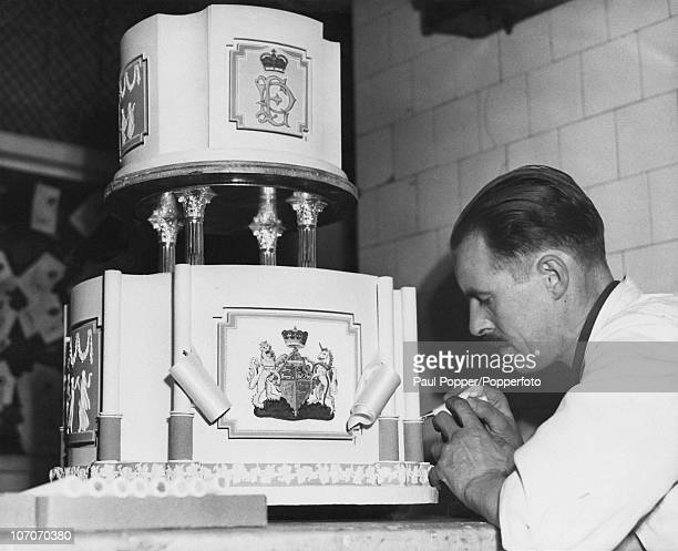FE Jacobs of the firm of Lyons of Cadby Hall working on a cake for the wedding of Princess Elizabeth and Philip Mountbatten Kensington London 7th...