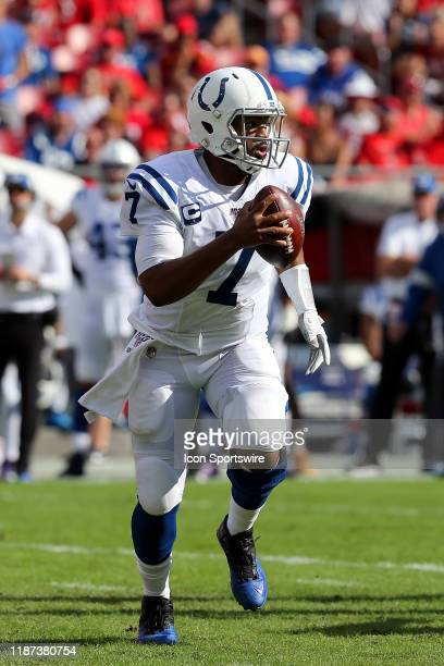 Jacoby Brissett of the Colts runs with the ball as he is pursued by Buccaneers defenders during the regular season game between the Indianapolis...