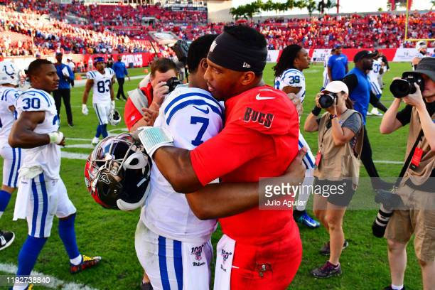 Jacoby Brissett of the Indianapolis Colts and Jameis Winston of the Tampa Bay Buccaneers hug after a 3835 Buccaneers win at Raymond James Stadium on...