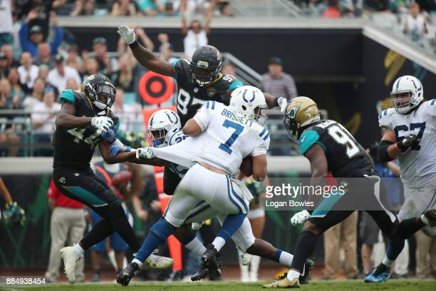 Jacoby Brissett of the Indianapolis Colts is pressured by a group of Jacksonville Jaguars defenders in the second half of their game at EverBank...