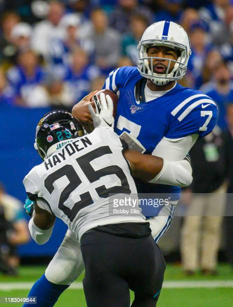 Jacoby Brissett of the Indianapolis Colts is sacked by D.J. Hayden of the Jacksonville Jaguars during the second quarter of the game at Lucas Oil...