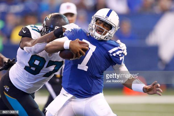 Jacoby Brissett of the Indianapolis Colts is sacked by Malik Jackson of the Jacksonville Jaguars during the first half at Lucas Oil Stadium on...
