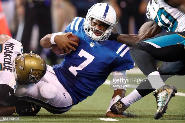 Jacoby Brissett of the Indianapolis Colts is sacked by Yannick Ngakoue of the Jacksonville Jaguars during the fourth quarter at Lucas Oil Stadium on...
