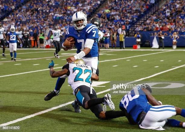 Jacoby Brissett of the Indianapolis Colts is tackled by Aaron Colvin of the Jacksonville Jaguars during the fourth quarter at Lucas Oil Stadium on...