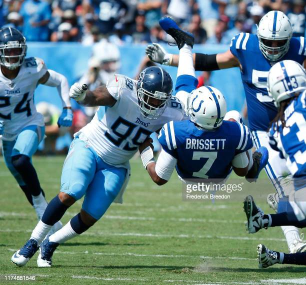 Jacoby Brissett of the Indianapolis Colts is upended by Jurrell Casey of the Tennessee Titans during the first half at Nissan Stadium on September...