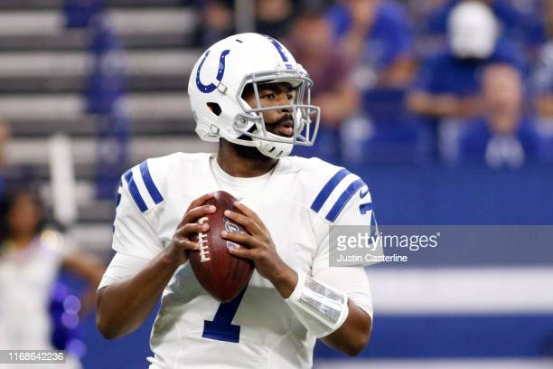 Jacoby Brissett of the Indianapolis Colts looks down the field during the first half of the preseason game against the Cleveland Browns at Lucas Oil...