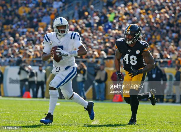 Jacoby Brissett of the Indianapolis Colts rolls out to pass against Bud Dupree of the Pittsburgh Steelers on November 3, 2019 at Heinz Field in...