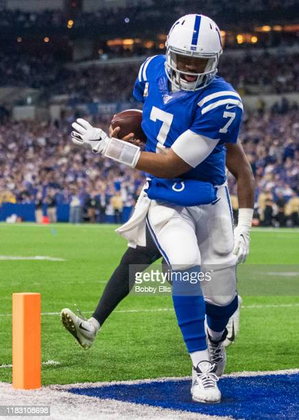 Jacoby Brissett of the Indianapolis Colts runs for a touchdown during the third quarter of the game against the Jacksonville Jaguars at Lucas Oil...