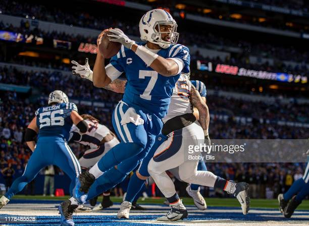Jacoby Brissett of the Indianapolis Colts scrambles out of the pocket as he attempts to avoid a safety during the third quarter of the game against...