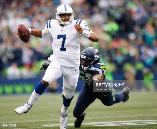 Jacoby Brissett of the Indianapolis Colts tries to escape defensive end Cliff Avril of the Seattle Seahawks in the first quarter at CenturyLink Field...