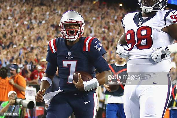Jacoby Brissett of the New England Patriots celebrates scoring a touchdown during the first quarter against the Houston Texans at Gillette Stadium on...