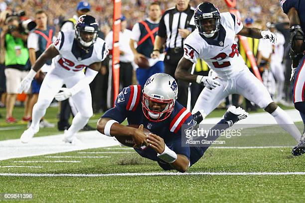 Jacoby Brissett of the New England Patriots dives for a touchdown during the first quarter against the Houston Texans at Gillette Stadium on...