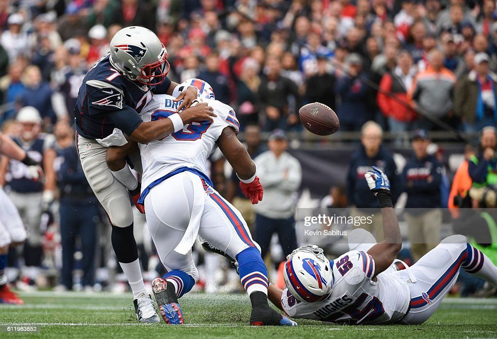 Jacoby Brissett #7 of the New England Patriots fumbles in the second quarter while being tackled by Zach Brown #53 of the Buffalo Bills at Gillette Stadium on October 2, 2016 in Foxboro, Massachusetts.