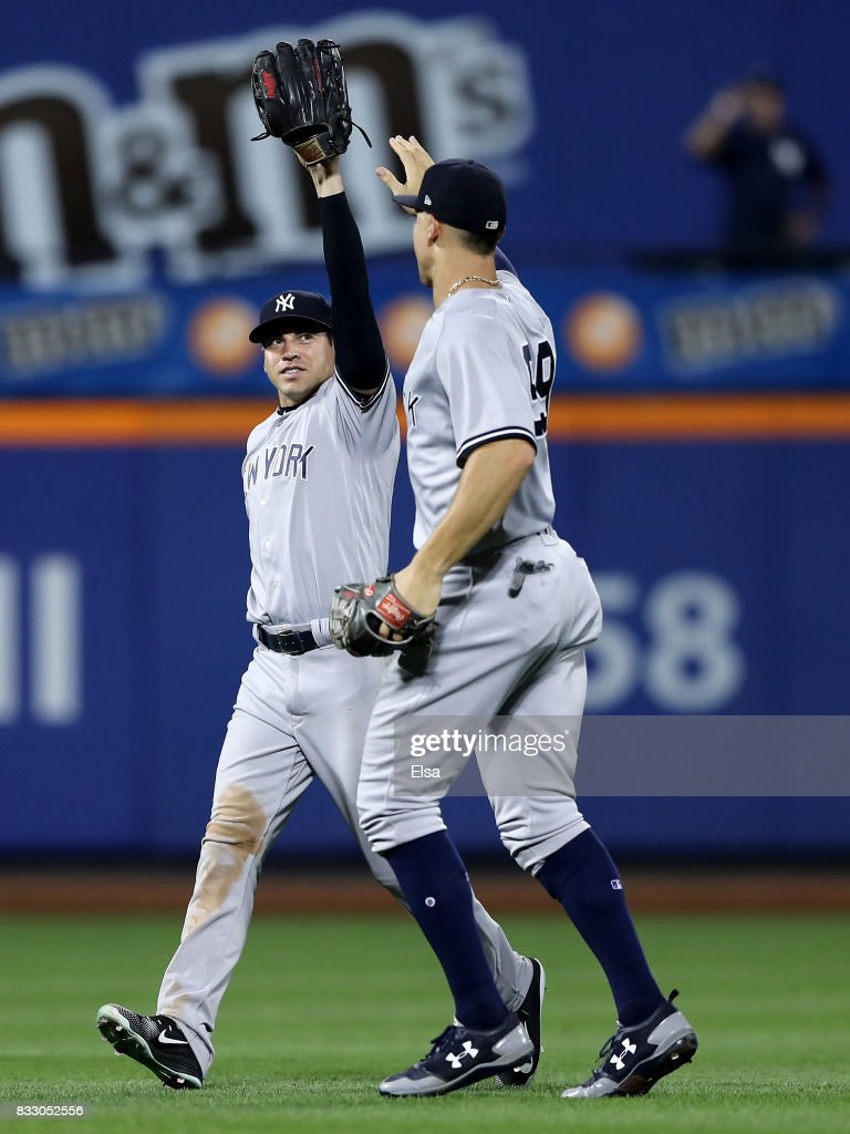 Jacoby Ellsbury #22 and Aaron Judge #99 of the New York Yankees celebrate the 5-3 win over the New York Mets during interleague play on August 16, 2017 at Citi Field in the Flushing neighborhood of the Queens borough of New York City.
