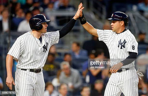 Jacoby Ellsbury and Chris Parmelee of the New York Yankees celebrate after both scored in the fifth inning against the Los Angeles Angels of Anaheim...