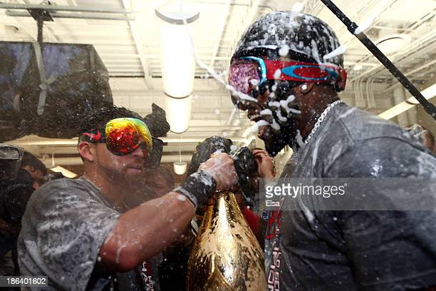 Jacoby Ellsbury and David Ortiz of the Boston Red Sox celebrate in the locker room after defeating the St. Louis Cardinals 6-1 in Game Six of the...