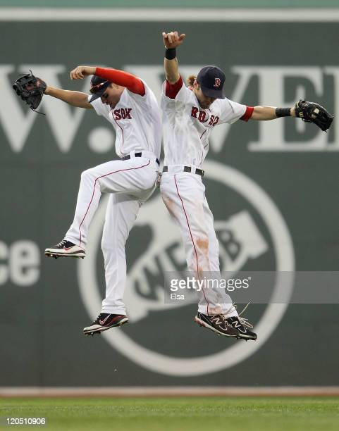 Jacoby Ellsbury of the Boston Red Sox and Josh Reddick celebrate the win over the New York Yankees on August 6 2011 at Fenway Park in Boston...