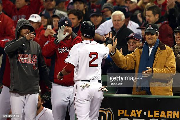 Jacoby Ellsbury of the Boston Red Sox celebrates a run with US Secretary of State John Kerry during Game Six of the 2013 World Series against the St...