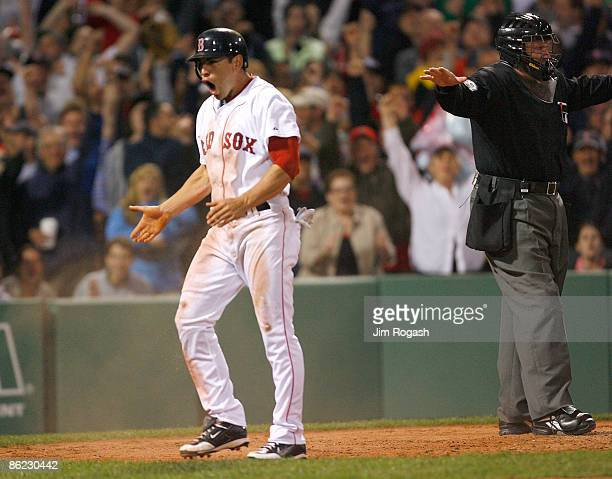 Jacoby Ellsbury of the Boston Red Sox celebrates after stealing home against the New York Yankees at Fenway Park April 26 2009 in Boston...