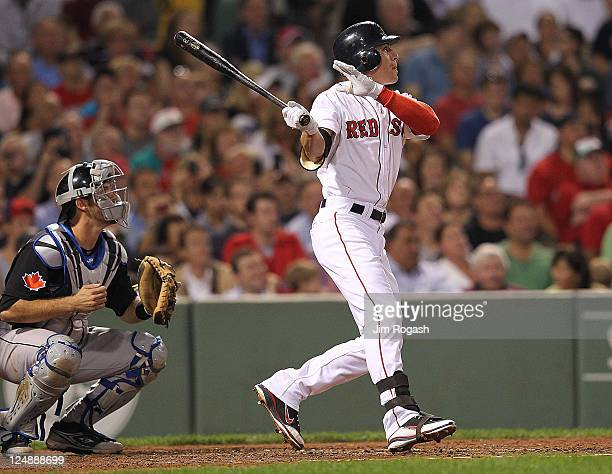 Jacoby Ellsbury of the Boston Red Sox connects for a home run in the fourth inning against the Toronto Blue Jays at Fenway Park September 13 2011 in...