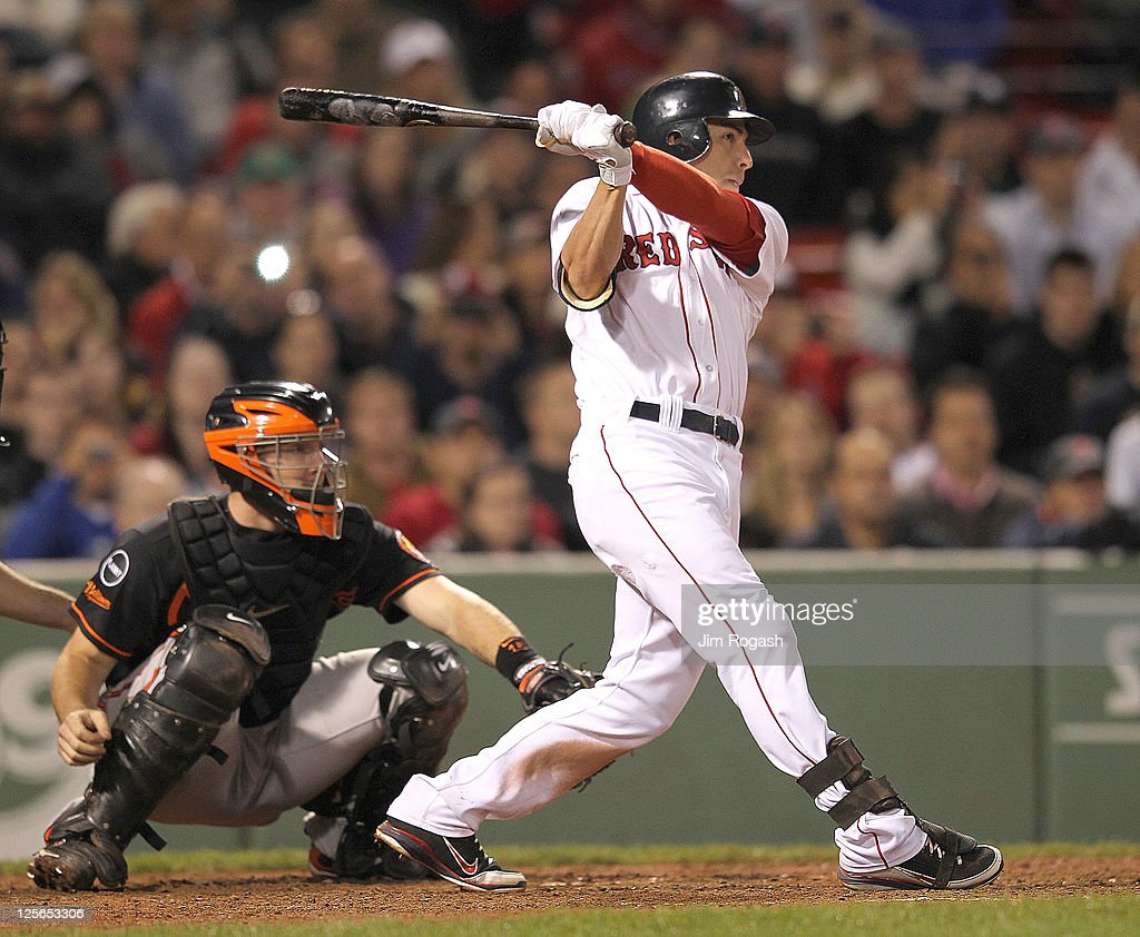 Jacoby Ellsbury #2 of the Boston Red Sox connects, sending the ball to deep right, for an inside the park home against the Baltimore Orioles defends in the seventh inning during the second game of a doubleheader at Fenway Park September 19, 2011 in Boston, Massachusetts.