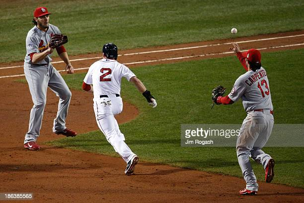 Jacoby Ellsbury of the Boston Red Sox gets out of a rundown with Kevin Siegrist and Matt Carpenter of the St Louis Cardinals in the fifth inning of...