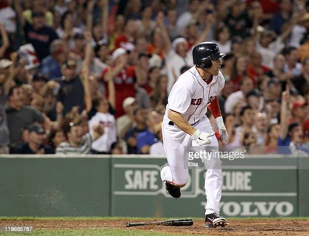 Jacoby Ellsbury of the Boston Red Sox hits a 2RBI single in the seventh inning against the Seattle Mariners on July 23 2011 at Fenway Park in Boston...